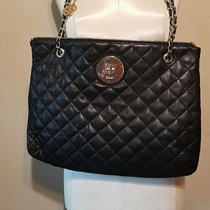 NWOT. DKNY quilted leather purse.